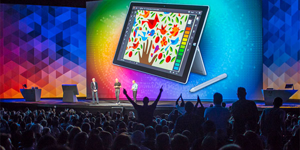 The crowd erupts at Adobe MAX 2014 as Microsoft announces they'll be giving every attendee a Surface Pro 3
